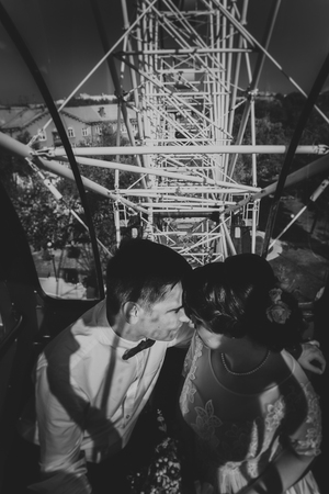 Black and white photo bride and groom in the Ferris wheel