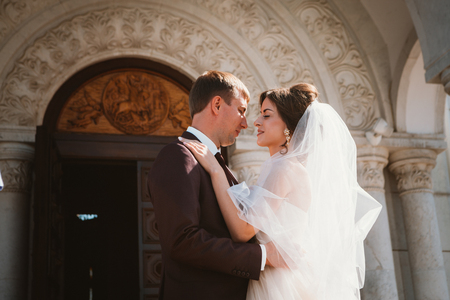 young couple groom and bride on church background Stock Photo
