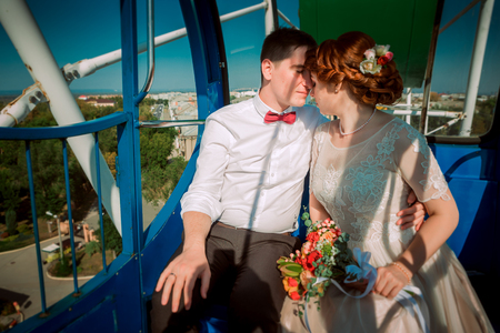 Bride and groom in the Ferris wheel Stock Photo