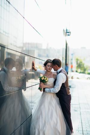 Wedding couple on backround mirror buildings
