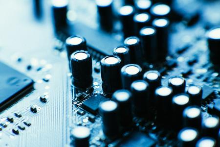 computer board capacitors blue color close up. Stock Photo