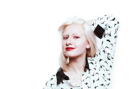 portrait blonde albino girl in studio on white background.