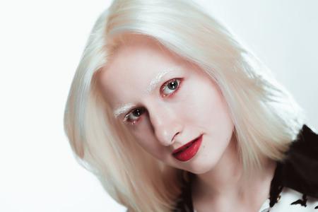 portrait of blonde albino girl in studio.