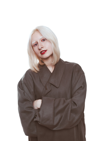 portrait of an albino girl in a raincoat in the studio.