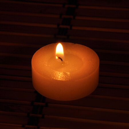 conflagrant: A picture of conflagrant candle is in darkness Stock Photo