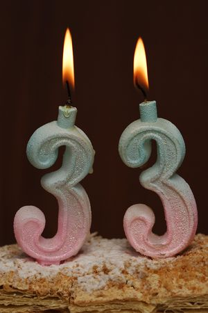 Candle in 33-year-old birthday cake Stock Photo - 2061497