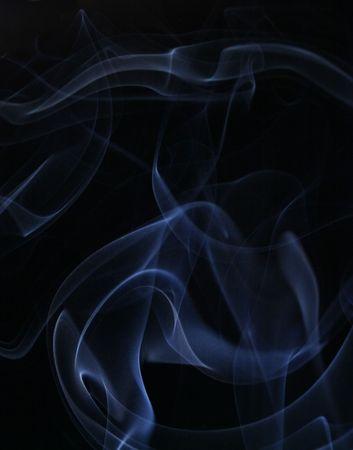 Blue smoke over black background photo