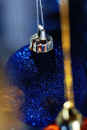 newyears: New-year`s tree decorations. Narrow depth of field. Stock Photo