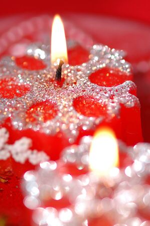 Red snowflake-shaped candles. photo