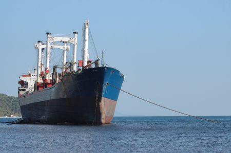 Stranded ship on the coast of black sea. photo