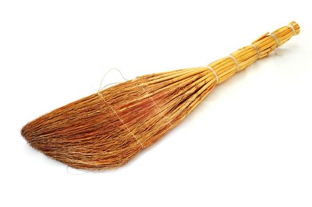 besom: Old besom on the white background. Stock Photo