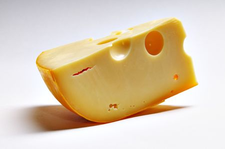 Big piece of cheese on the white background.