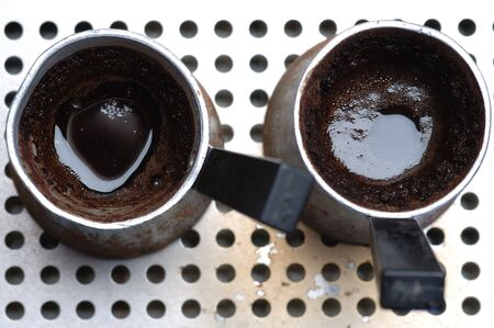 ebonite: Hot turkish coffee in the jezve. Stock Photo