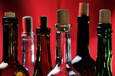Wine bottles on the red background. Narrow depth of field. Stock Photo - 3361025