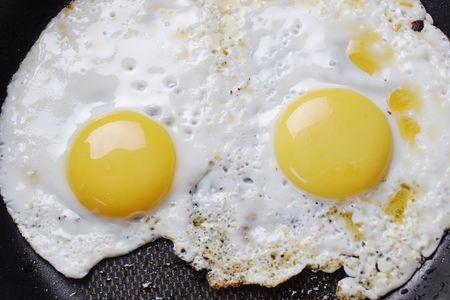 fryingpan: Hot fried eggs on the frying-pan.