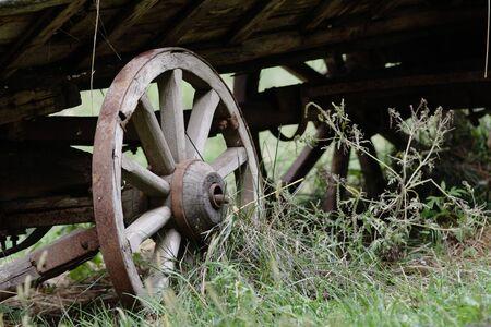 waggon: Old wooden waggon wheel. Close-up. Stock Photo