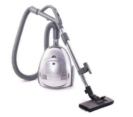 dusty: Vacuum cleaner on the white background. Old and dusty.
