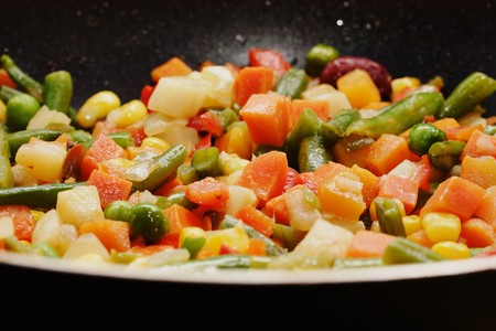 Fried vegetables on the skillet. Hot and fresh. Narrow depth of field. photo