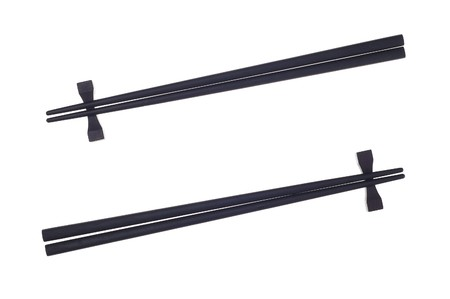 Black chopsticks isolated on the white background. 스톡 콘텐츠