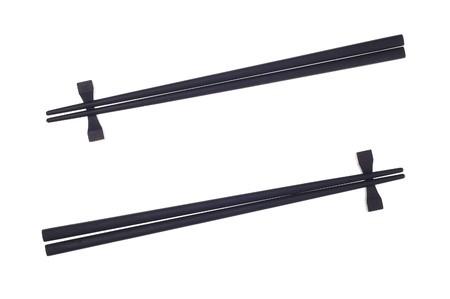 Black chopsticks isolated on the white background. Stock Photo