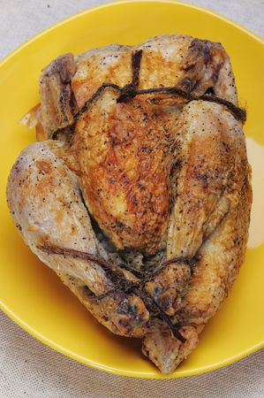 Grilled chicken on the yellow plate. Stock Photo - 4623028