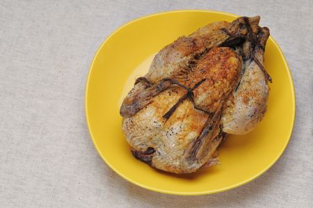 Grilled chicken on the yellow plate. Stock Photo - 4622798