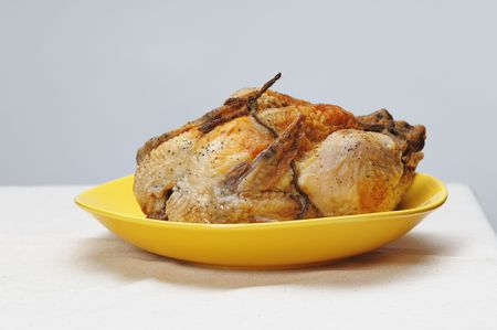 Grilled chicken on the yellow plate. Stock Photo - 4622895