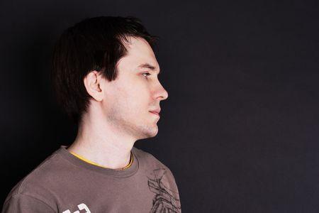 Unshaven men in casual wear posing in the studio. Dark background. Profile. Stock Photo - 5755167