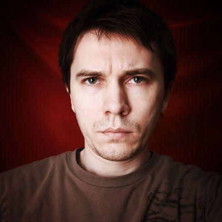 Unshaven men in casual wear posing in the studio. Dark red background. Stock Photo - 5917608