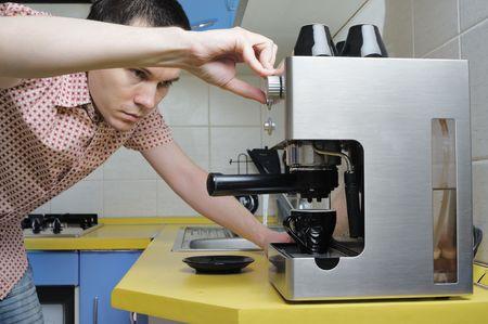 Short hair men making espresso on the kitchen. Stock Photo