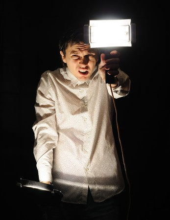 perplexity: Man with two lamps wanna find something in the dark. Perplexity. Stock Photo