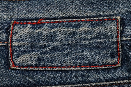 Jeans texture. Fragment. Empty label. 스톡 콘텐츠