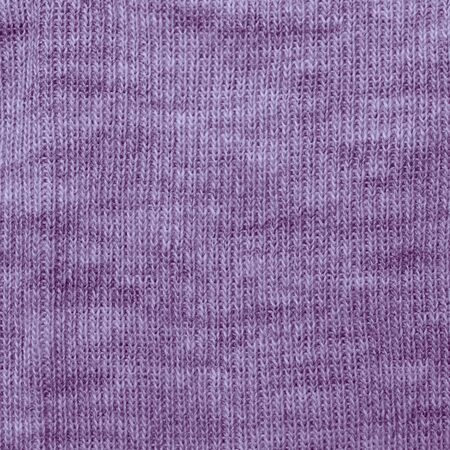 Knitted fabric maked from blended yarn. Texture. photo