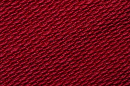 Knitted fabric. Texture. Close-up. Red color. photo