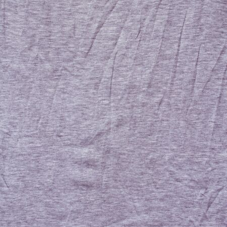 Knitted fabric made from blended yarn. Texture. photo