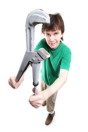 Man with big adjustable spanner in the hands. photo