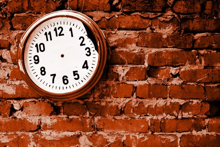 stop time: Broken clock without hands on the brick wall. Stock Photo