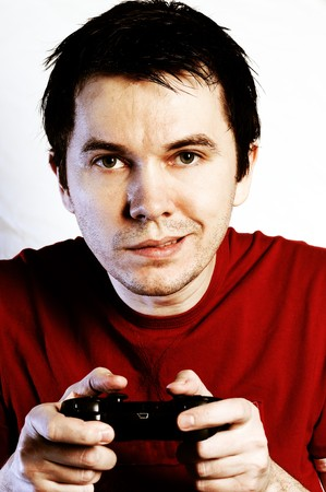 videogame: Man with game pad playing videogame. White background. Stock Photo