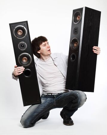 Man with audio system posing on the white background. photo