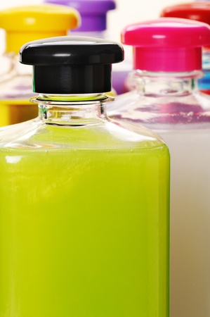 Bottles with color liquid soap. Close-up. Narrow depth of field. 스톡 콘텐츠