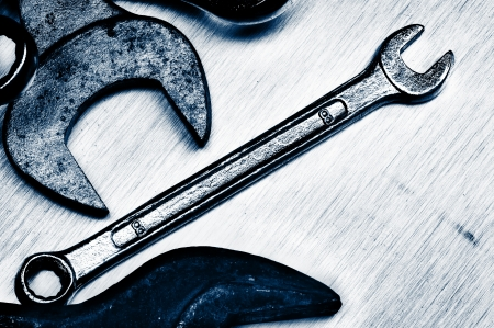 mechanic tools: Hand tools. Old, rusty and scratched. Close-up. Blue tint.