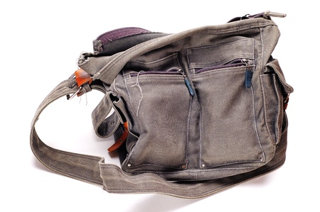 Canvas field bag on the white background. Old and dirty. Stock Photo