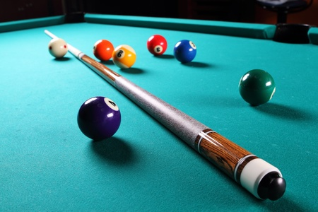 billiards cue: Billiard table with balls  Close-up  Narrow depth of field  Stock Photo