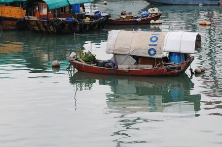 Boats in Aberdeein harbour, Hong Kong, China  photo
