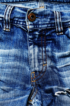 Aged blue jeans close-up. Texture.