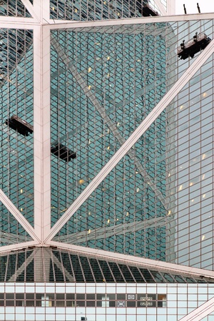 Window cleaners on the skyscraper in the Hong Kong city centre  photo