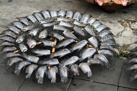 Drying fish on the street of the Bangkok  Thailand  photo