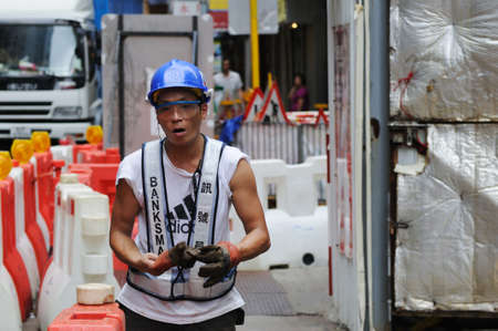 HONG KONG - JULY 16: Worker in working clothes on the street of Hong Kong. Hong Kong, China - July 16, 2011.