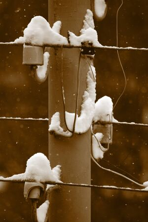 powerline: The snow on the electric powerline  Close-up  Sepia tint