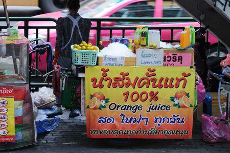 BANGKOK - SEPTEMBER 2: Thai woman sells fruit juice on the street in downtown of Bangkok. Bangkok, Thailand - September 2, 2011. Stock Photo - 16585515